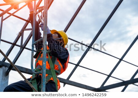 Construction worker climbing ladder Stock photo © elenaphoto