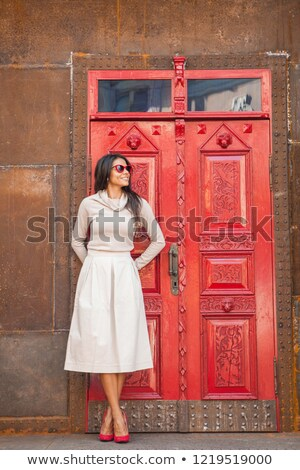 Glamorous woman wearing red dress and looking away stock photo © wavebreak_media