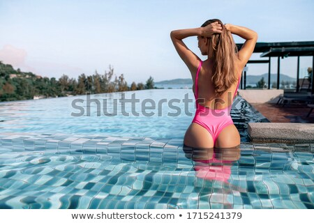 Fashionable young blonde girl posing in swimsuit. Stock photo © PawelSierakowski