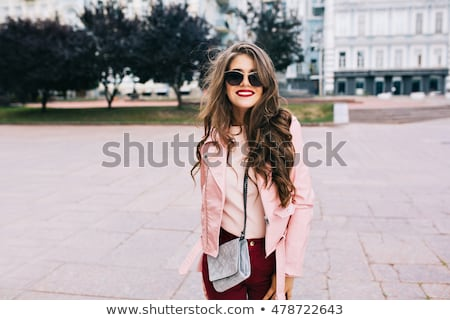 Attractive smiling woman portrait with long curly hair style Stock photo © Victoria_Andreas