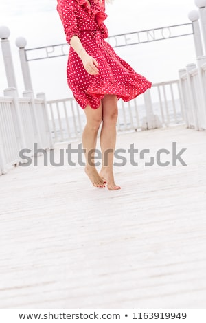 beautiful woman in red dress on the yacht stock photo © ssuaphoto