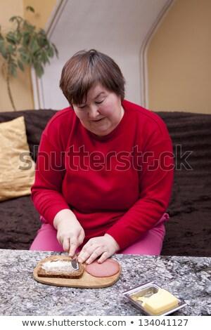 Handicapées femme sandwich maison roses pain Photo stock © Pasiphae