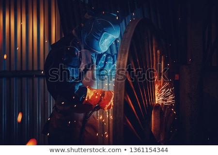 a welder working a torch at shipyard Stock photo © rufous