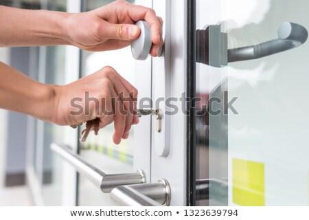 Nő zárat kinyit ajtó társasház épület biztonság Stock fotó © photography33