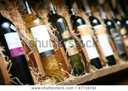 Closeup shot of wine shelf Bottles Stock photo © zzve