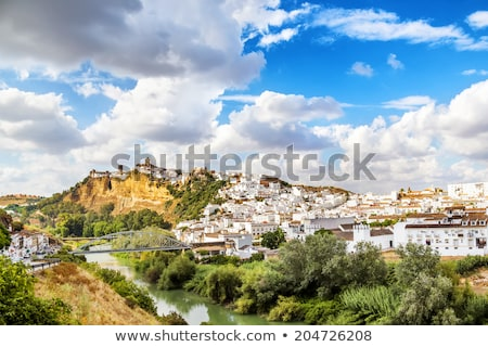 Narrow street in Arcos de la Frontera, Spain stock photo © tboyajiev