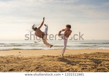 Capoeira sziluett naplemente férfi sport háttér Stock fotó © adrenalina
