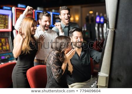 Barátok kaszinó játékautomata férfi néz nő Stock fotó © Kzenon