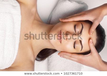 feliz · mujer · cabeza · masaje · sonriendo · flor - foto stock © andreypopov