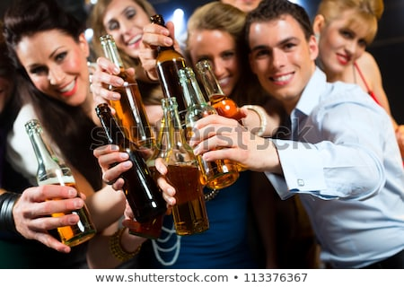 Couple in bar drinking beer flirting  Stock photo © Kzenon