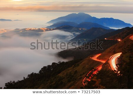 lanscape with amazing mountains and curved road Stock photo © feedough