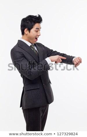 meglepődött · üzletember · tanácsadás · óra · férfi · óra - stock fotó © jaycriss