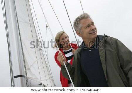 Mujer rubia mirando vela barco vista posterior sexy Foto stock © feedough