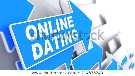 Online Dating on Blue Direction Arrow Sign. Stock photo © tashatuvango