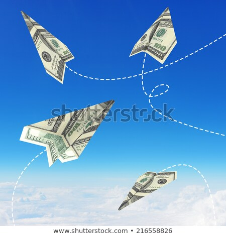 paper airplane made of hundred dollar bill stock photo © cherezoff