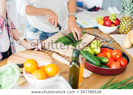 Young woman preparing lunch stock photo © jiri_miklo