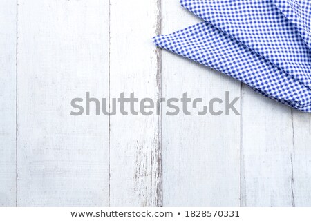 Whisk on wooden background with a blue checkered tablecloth Stock photo © Zerbor