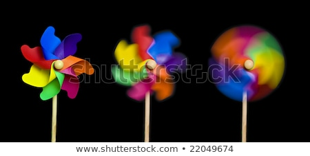 Three colorful toy windmills  Stock photo © dezign56
