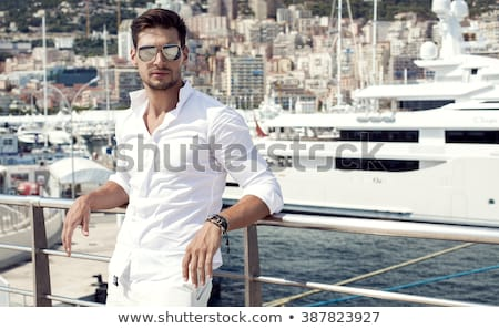 handsome man on yacht stock photo © anna_om