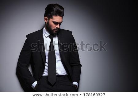 Jovem barba homem sorridente tanto mãos Foto stock © feedough