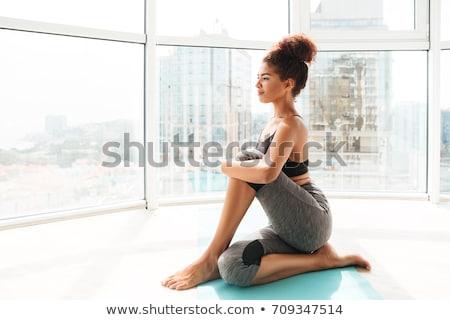 Fiatal afrikai nő nyújtás jóga pozició Stock fotó © HASLOO