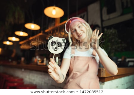 Pirulí forma panda rosa alimentos fondo Foto stock © OleksandrO