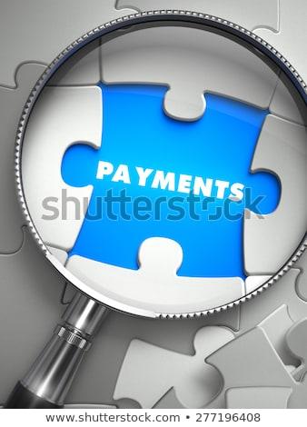 Payments - Missing Puzzle Piece through Magnifier. Stock photo © tashatuvango