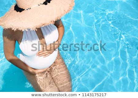 pregnant woman on tropical resort stock photo © anna_om