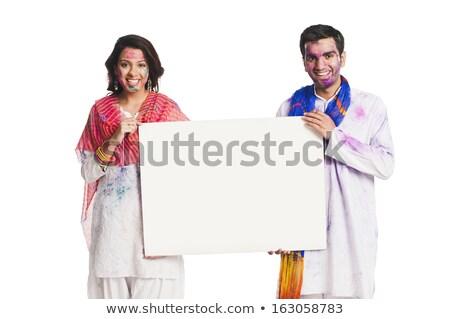 couple celebrating holi and holding a blank placard stock photo © imagedb