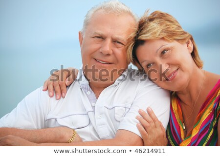 Smiling elderly married couple on veranda near seacoast, concern Stock photo © Paha_L