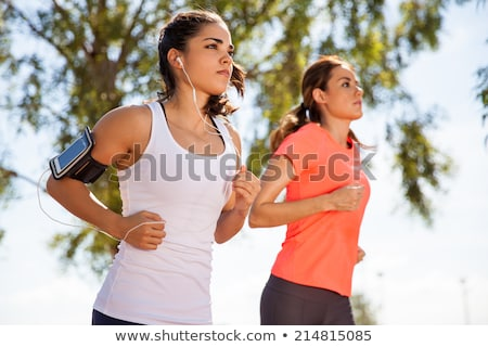 Stock photo: Two cute girls jogging outdoors