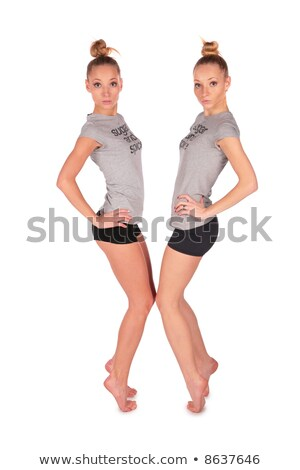 Twin sport girls stands on tiptoe face-to-face Stock photo © Paha_L