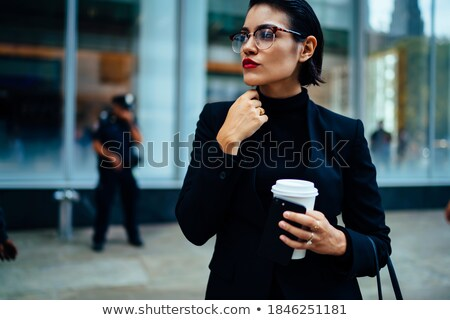 Intelligent adult female with red cup Stock photo © ozgur