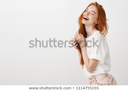 Beauty portrait of a pretty redhead woman stock photo © deandrobot