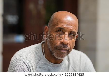 Człowiek czarny myślenia patrząc w dół czarny garnitur Zdjęcia stock © feedough