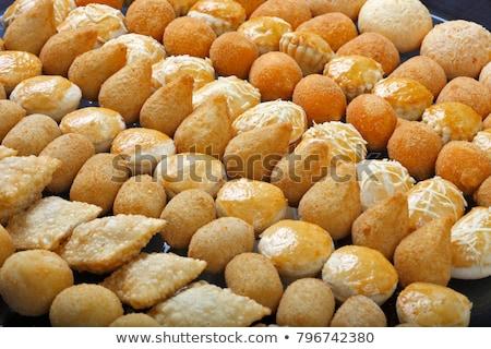 Mixed Brazilian deep fried chicken snack, esfihas and pastry. Stock photo © paulovilela