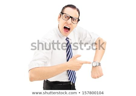 enojado · mujer · de · negocios · senalando · pie · oficina - foto stock © rastudio