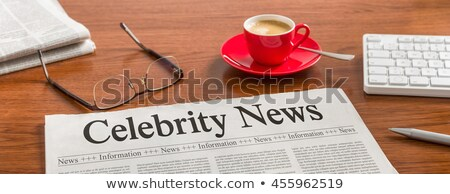 A newspaper on a wooden desk - Celebrity News Stock photo © Zerbor