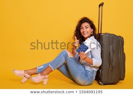 young woman with a yellow suitcase looking to map near the white stock photo © vlad_star