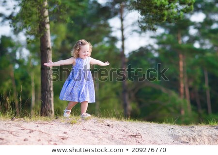 little girl playing with sand in the forest stock photo © superelaks