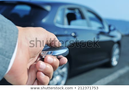 man opening his car with the control remote key Stock photo © nito