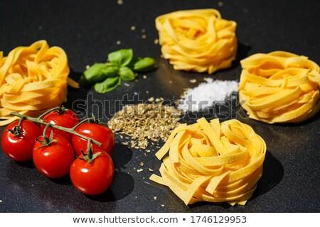 various types of italian pasta and cherry tomato stock photo © tasipas