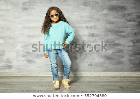 Expressive girl in a grungy room Stock photo © konradbak