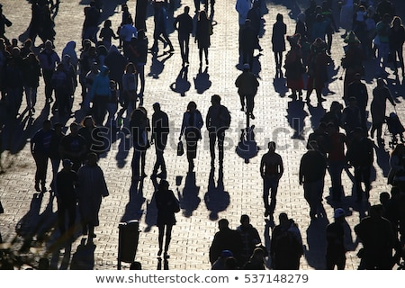 Long shadows of pedestrian people on the street Stock photo © stevanovicigor