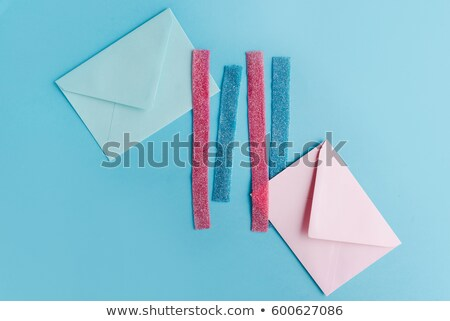 Colorful sugar liquorice stripes and two paper envelopes Stock photo © deandrobot