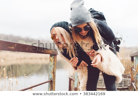 young beautiful woman having fun in winter park stock photo © dariazu