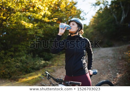 cyclist drinking from a bottle of water stock photo © is2
