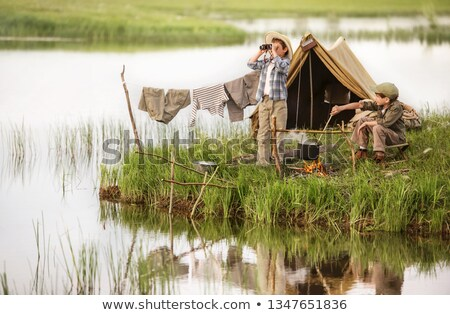 Two boys looking out of tent Stock photo © IS2
