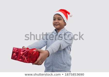 Boy, 10 holding present Stock photo © IS2