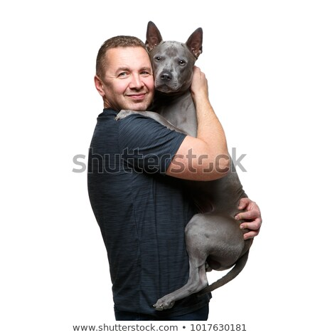 man holding thai ridgeback dog Stock photo © svetography